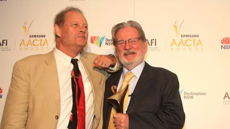 Prolific director Bruce Beresford and cinematographer Don McAlpine with trophy in hand at the 2012 AACTA Awards in Sydney.