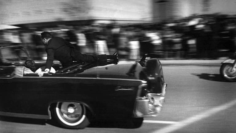 John F Kennedy's limo speeds toward Parkland Hospital moments after he was shot.