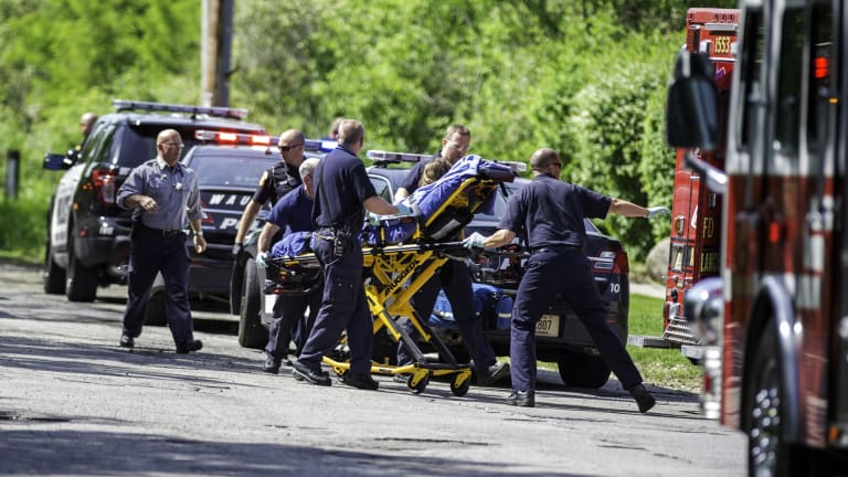 Rescue workers take a stabbing victim to an ambulance in Waukesha, Wisconsin, in May last year. Prosecutors say two 12-year-old girls stabbed their 12-year-old friend nearly to death in the woods to please a mythological creature they learned about online.