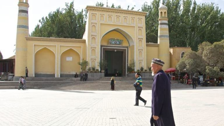 An elderly Uighur man in front of Kashgar's Id Kah mosque.