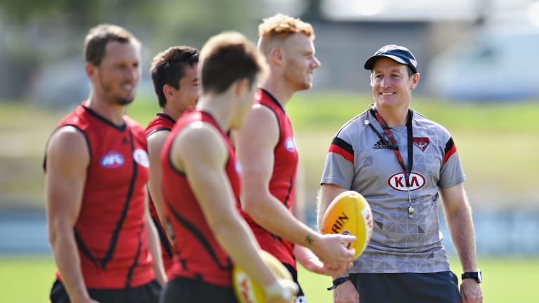 People person: Essendon coach John Worsfold with his players during a training session.
