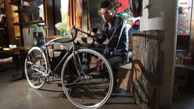 Mocan & Green Grout co-owner David Alcorn with an example of the Goodspeed bicycles they produce and sell.