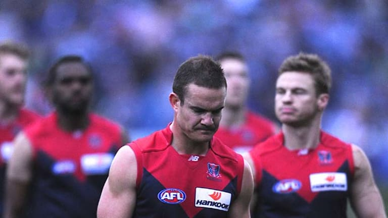 Dee-saster: Skipper Brad Green leads off his Demons after the Skilled Stadium slaughter.