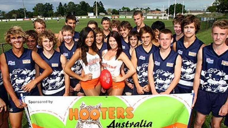The Broadbeach Cats junior football team with some of their new supporters.