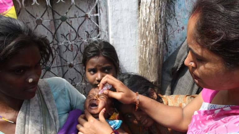 Polio-free ... it's been one year since the last reported case of the disease in India. Four-month-old Krishna is vaccinated against polio in northern India.