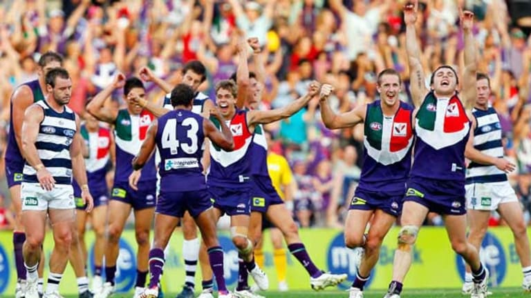 Fremantle players show their delight, and Geelong players their disappointment, as the siren sounds to end yesterday's thrilling shoot-out at Subiaco Oval, which left  the Dockers 3-0 and the Cats 2-1.