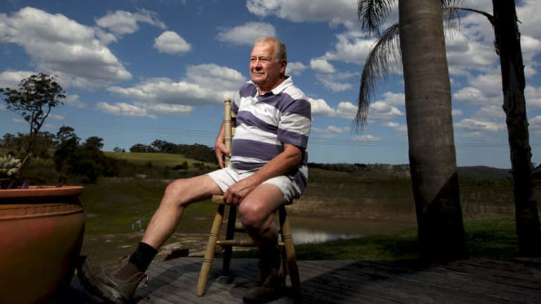 Farmer Anthony Zizza in front of his dam wall which has asbestos contaminated dirt in it, on his Mangrove Mountain property north of Sydney.