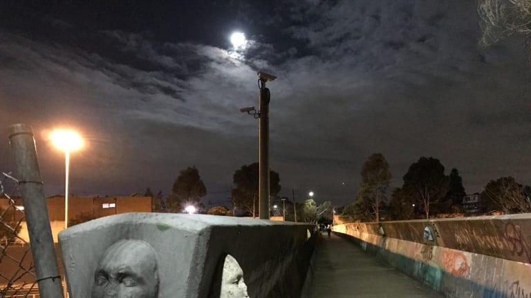 Brunswick's bridge of faces is especially creepy after dark.