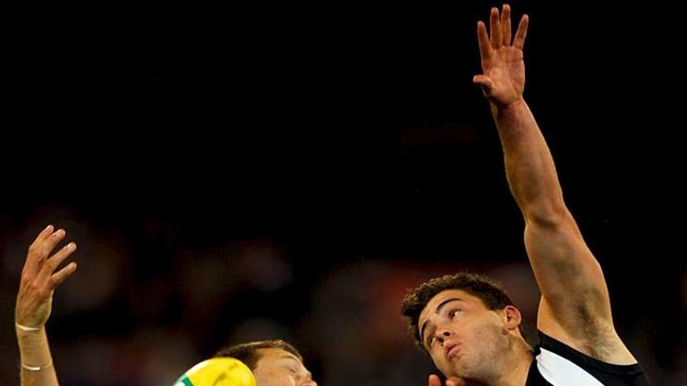 Cats defender David Wojcinski and Magpies forward Jarryd Blair compete in round eight.