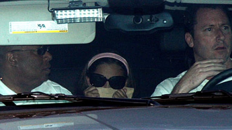 Mourning ... Michael Jackson's daughter, Paris, arrives at Forest Lawn Memorial Park to view his body.