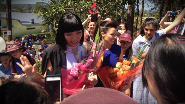 """We love you, Dami!"": Dami Im and Dannii Minogue arrive at John Paul College."