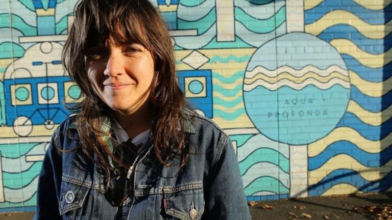 MELBOURNE, AUSTRALIA - APRIL 20:  Singer-songwriter and guitarist Courtney Barnett poses for a photo  in front of the Aqua Profunda sign  at the Fitzroy Pool on April 20, 2015 in Melbourne, Australia.  (Photo by Pat Scala/Fairfax Media) *** Local Caption *** Courtney Barnett