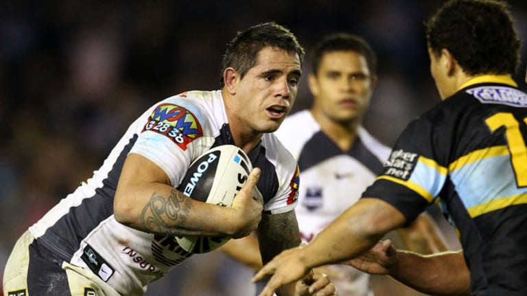 The Broncos' Corey Parker is tackled by the Sharks' defence.