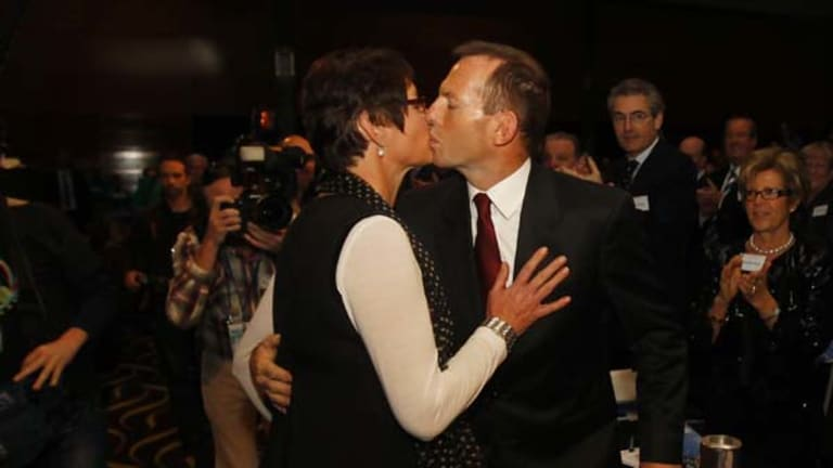 Tony Abbott kisses his wife Margie at the Liberal Party conference in Perth.