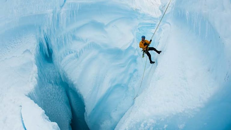 James Balog rappels into Survey Canyon on the Greenland Ice Sheet, in the film <i>Chasing Ice</i>.