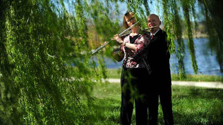 Virginia Taylor and Vernon Hill play by  Lake Burley Griffin in late 2011 to launch the Canberra Symphony Orchestra's 2012 season.