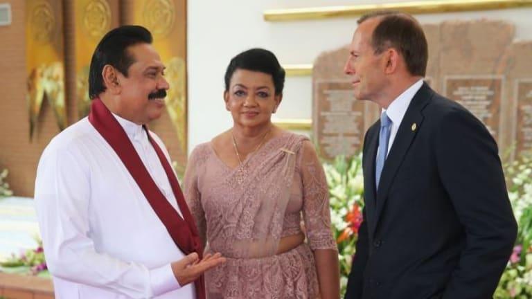 All smiles: Mr Abbott with Sri Lankan President Mr Mahinda Rajapaksa and his wife.