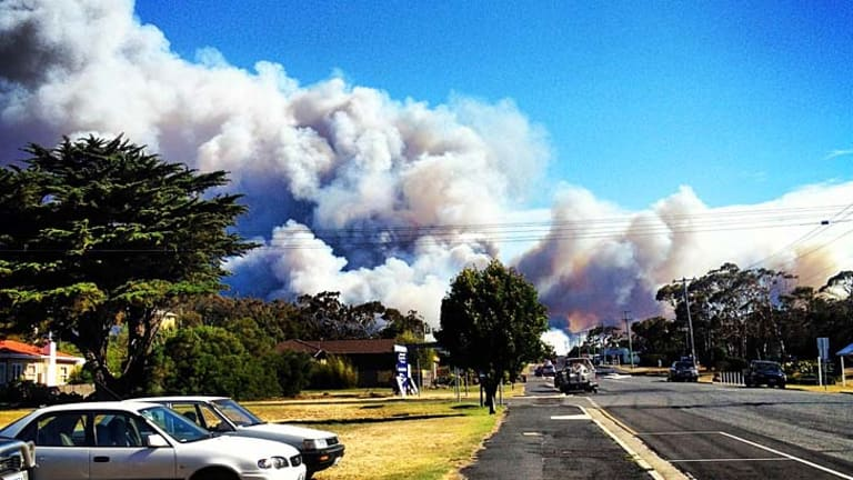 Thick smoke covers the sky outside the town of Bicheno, one of at least 25 fires burning in Tasmania.
