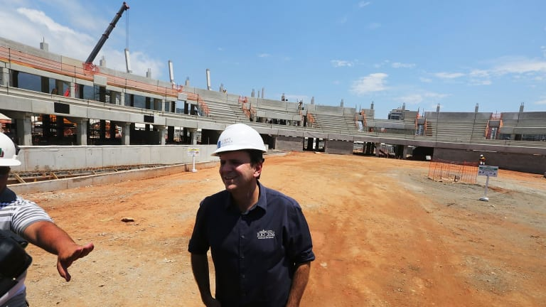 Rio Mayor Eduardo Paes inspects construction work at the Olympic Park's Tennis Centre in December.