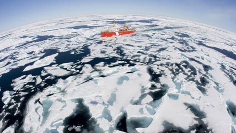 To the ends of the earth ... icebreaker Louis S. St Laurent makes its way through  ice in Baffin Bay, Canada. Scientists predict summer ice will soon disappear from the region.