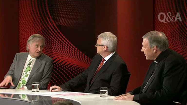 Clashing ideologies … Tony Jones, centre, plays the referee to Richard Dawkins, left, and Cardinal George Pell on Q&A last night.