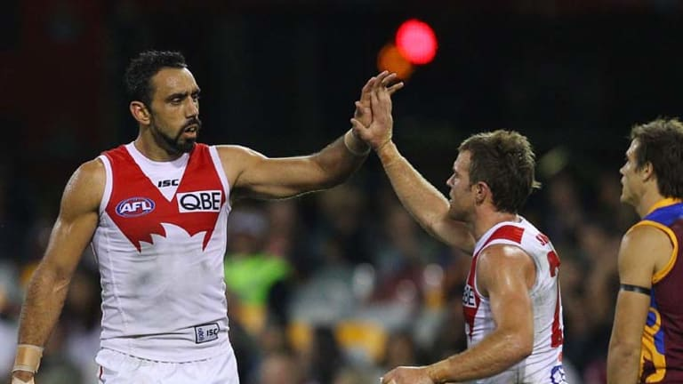 Goal parade ... Adam Goodes and Ben McGlynn celebrate a major last night as Brisbane copped a pounding.