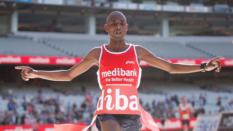 Breaking the tape: Kenya's Isaac Birir takes out the men's race.