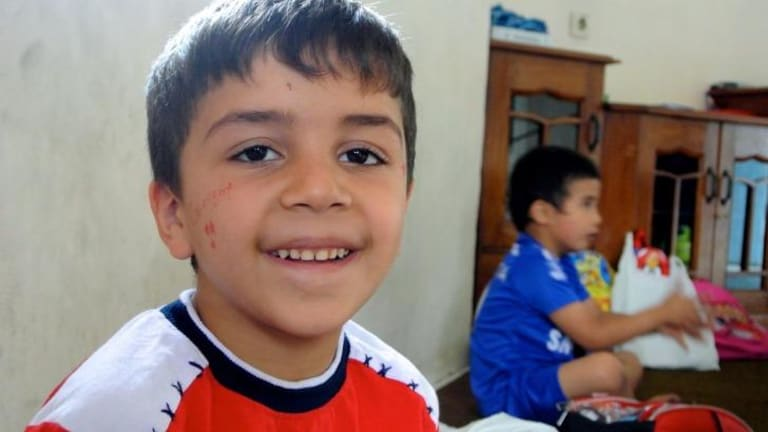 All smiles: A young boy at the learning centre.