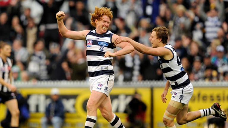 Geelong captain Cameron Ling and Mitch Duncan celebrate a goal against Collingwood in the grand final.