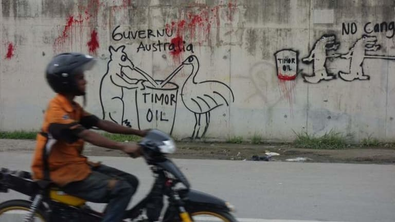Australia embassy in East Timor showing a vandal attack on an adjacent wall.