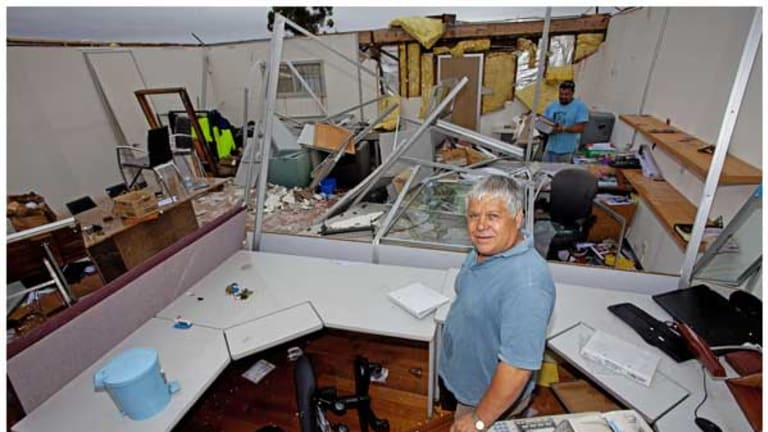 Chris Tsiavis in his flooded Laverton office.
