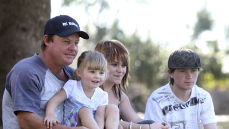 Grieving... David Cuthbertson with Alyssa, Nicole and Steven.