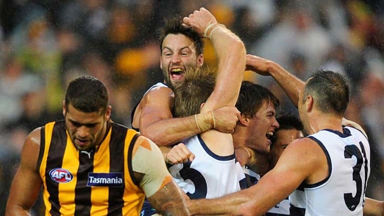 Geelong celebrate after the final siren.