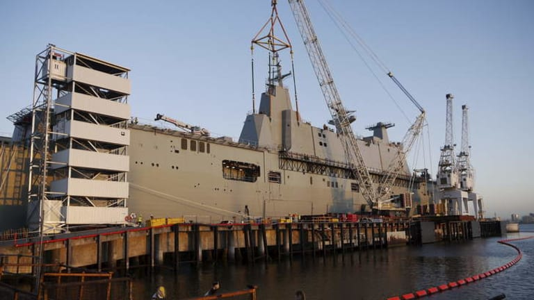 CAPITAL AFLOAT: HMAS Canberra is almost 28,000 tonnes. The combined cost of Canberra and its sister ship, Adelaide, will be more than $3.1 billion.