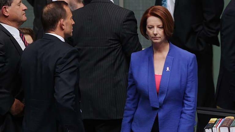 Political rivals ... Julia Gillard walks past Tony Abbott.