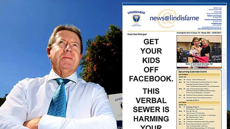 """Lindisfarne principal Chris Duncan and the school newsletter bearing his stark warning about Facebook. <a href=""""http://www.mydailynews.com.au/story/2011/09/22/get-kids-off-facebook""""><b>Photo: John Gass/Daily News</a></b>"""