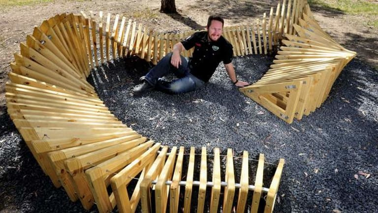 Artist Dan Stewart-Moore consulted with Uriarra residents on his sculpture incorporating 100 timber triangles.