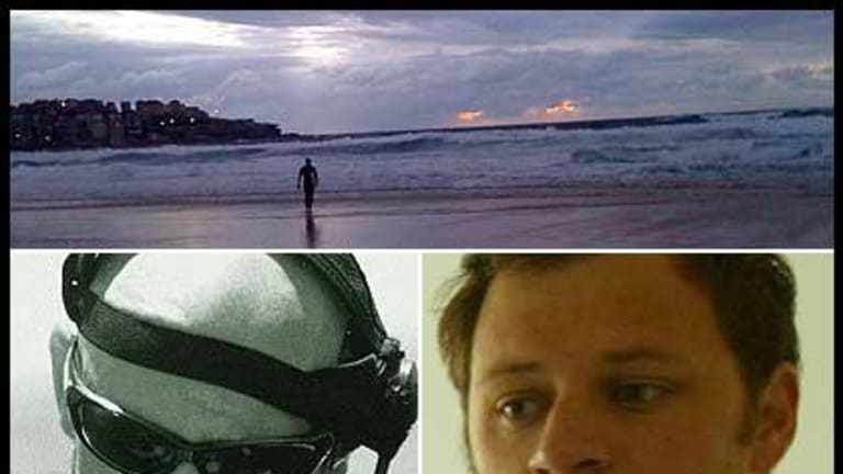 A lone surfer looks out at Bondi this morning after shark attacks on Paul de Gelder, left, and last night's victim Glenn Orgias, right and bottom.