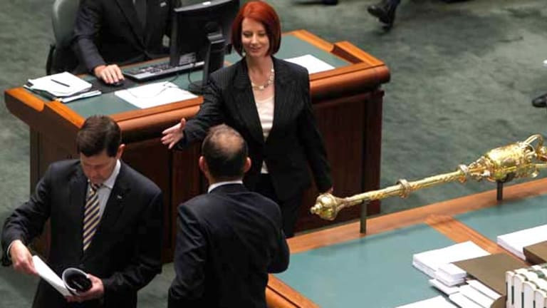 Prime Minister Julia Gillard enters Parliament for her first question time as Prime Minister and shakes hands with Opposition Leader Tony Abbott.