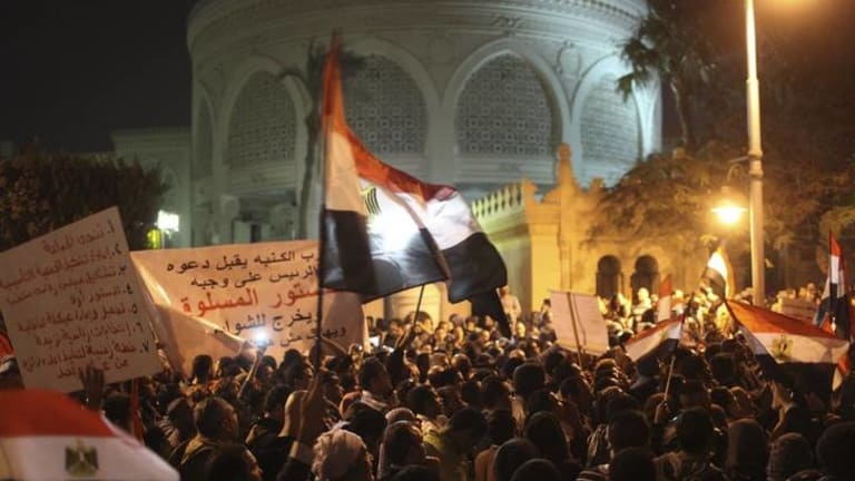 Protesters chant anti-Morsi slogans in front of the presidential palace in Cairo after Egypt's opposition called for mass protests against the government on Tuesday.