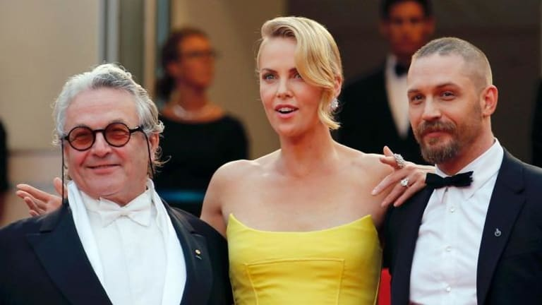 Director George Miller (from left) with  Charlize Theron and Tom Hardy on  the red carpet as they arrive for the screening of  Mad Max: Fury Road at the  Cannes Film Festival.