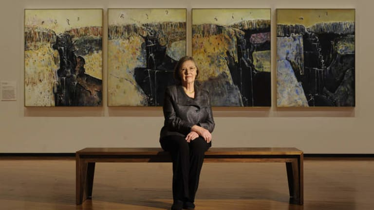 """""""We haven't tried to get someone pushing the barrow to shove prices up"""" … Lyn Williams in front of her husband's four-panel """"Waterfall polyptych"""", from 1979."""