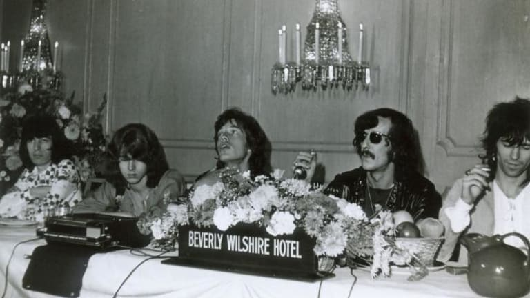 Sympathy for the devils: The Rolling Stones at a press conference in the 1960s with Sam Cutler, second from right.