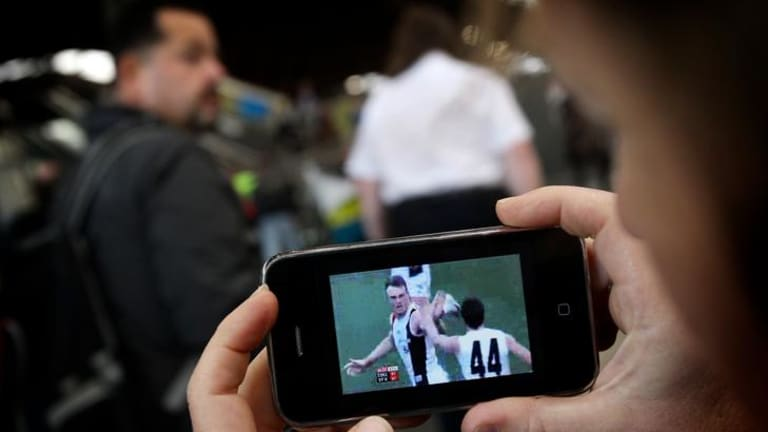 """Optus's AFL telecasts on mobile phones and computers could put Telstra's broadcast rights deal """"up in the air""""."""