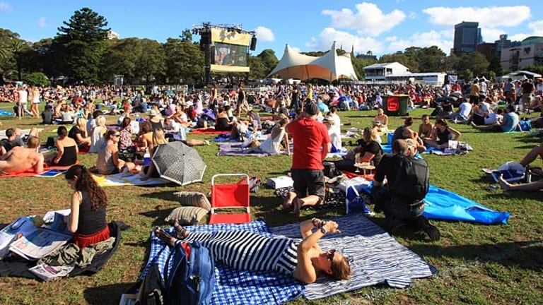 Tropfest faithful ... crowds enjoy a late summer evening as they prepare for the final Tropfest in Sydney's Domain.
