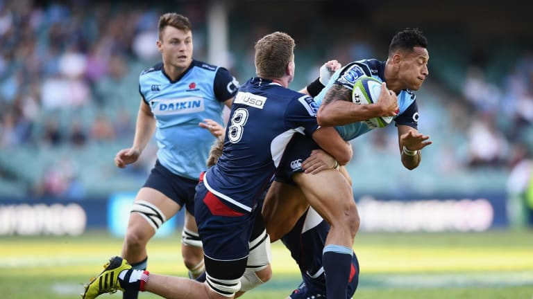 Game-breaker: Israel Folau runs at the Rebels defence in round six.