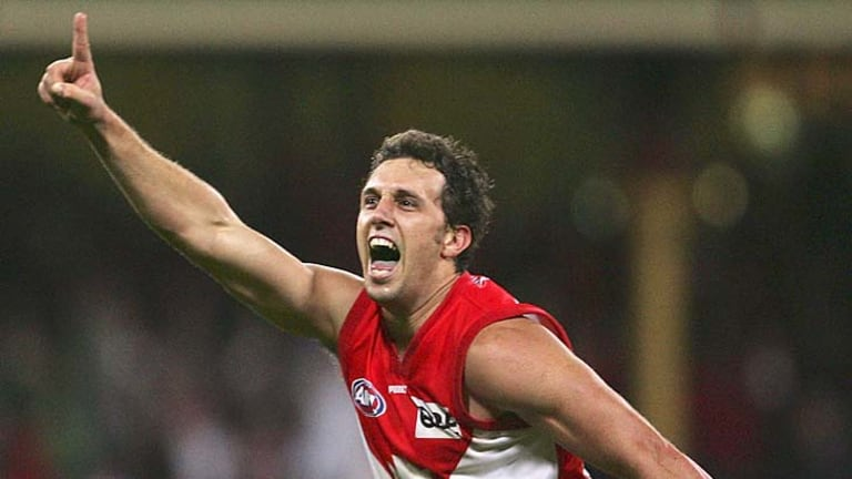 Nick Davis celebrates after kicking the winning goal in the semi-final against Geelong in 2005.