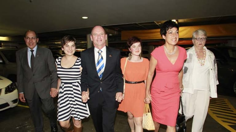Victorious ... Campbell Newman arriving at the Hilton Hotel with his family last night.