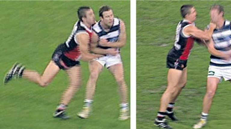 St Kilda's Steven Baker clashes with Stevie Johnson.