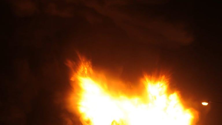Fireballs exploding from the burning factory have rattled nearby homes in Canberra.